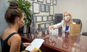 The Acne Treatment Center - Jane Dudik Helping a Client
